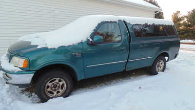 1999 Ford F150 Reg Cab, $1999. Photo 1